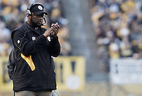 PITTSBURGH, PA - OCTOBER 30:  Head coach Mike Tomlin of the Pittsburgh Steelers cheers on his team against the New England Patriots during the game on October 30, 2011 at Heinz Field in Pittsburgh, Pennsylvania.  (Photo by Jared Wickerham/Getty Images)