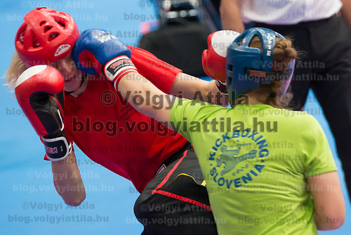 Gold medalist Ursa Terdin (R) of Slovenia and silver medalist Stefanie Kemper (L) of Germany fight in the 2 LC 043 S F -70 kg final at the WAKO (World Association of Kickboxing Organizations) World Kick-boxing Championships in Budapest, Hungary on Nov. 10, 2017. ATTILA VOLGYI