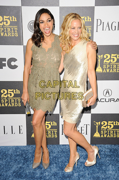 ROSARIO DAWSON & MARIA BELLO.The 25th Annual Film Independent Spirit Awards at the LA Live Event Deck in Los Angeles, California, USA..March 5th, 2010  .full length gold nude beige cream one shoulder shiny green lace dress peep toe shoes grey gray clutch bag mouth open .CAP/ROT.©Lee Roth/Capital Pictures
