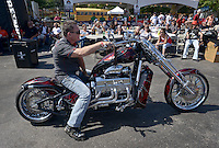 NWA Democrat-Gazette/BEN GOFF @NWABENGOFF<br /> Rod Guinn of Muskogee, Okla. rides off on his custom chopper on Saturday Sept. 26, 2015 after competing in the Stokes Air Battle of the Bikes at the annual Bikes, Blues & BBQ motorcycle rally in downtown Fayetteville. Guinn won the chopper category with the 500 horsepower bike built by V8 Choppers in Miami, Okla.