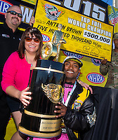 Nov 1, 2015; Las Vegas, NV, USA; NHRA top fuel driver Antron Brown (right) celebrates with wife Billie Brown after clinching the 2015 top fuel dragster world championship during eliminations for the Toyota Nationals at The Strip at Las Vegas Motor Speedway. Mandatory Credit: Mark J. Rebilas-USA TODAY Sports