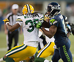 Seattle Seahawks wide receiver blocks Percy Harvin (11) Green Bay Packers cornerback Tramon Williams in the NFL Kickoff Game game at CenturyLink Field in Seattle, Washington on September 4, 2014. Harvin caught seven passes for 59 yards, rushed for 41 and returned three kickoffs for 60 yards. The Seahawks pounded the packers 36-16. ©2014  Jim Bryant Photo. ALL RIGHTS RESERVED.