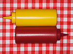 Yellow and red plastic bottles for spice or sauce