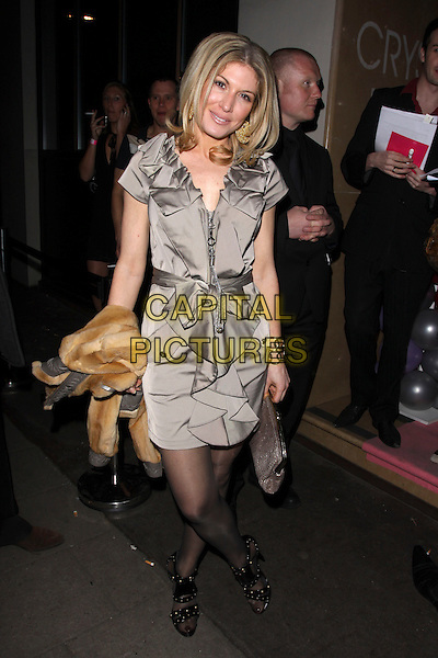 HOFIT GOLAN.Attitude's Sweet 16 Birthday Party held at the Mayfair Hotel, London, England, UK. .May 5th 2010.full length beige khaki grey gray dress ruffles ruffle shirt collar folded bow belt waist black tights open toe sandals.CAP/AH.©Adam Houghton/Capital Pictures.