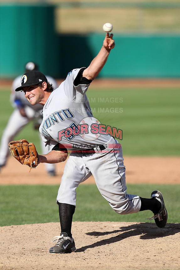 Phoenix Desert Dogs pitcher Evan Crawford #39 during an Arizona Fall League game against the Mesa Solar Sox at HoHoKam Park on November 3, 2011 in Mesa, Arizona.  Mesa defeated Phoenix 8-7.  (Mike Janes/Four Seam Images)