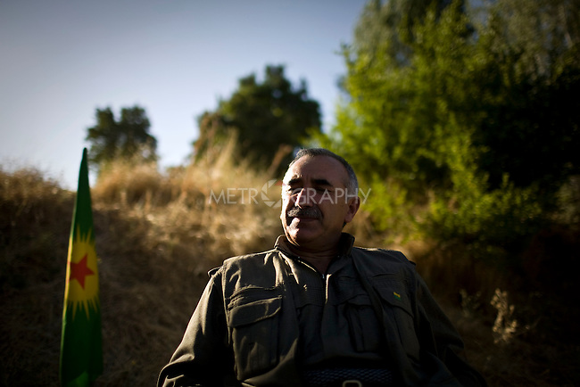 QANDIL, IRAQ: Murad Qarayilan, acting leader of the Kurdistan Worker's Party (PKK) responds to questions during an interview...The Kurdistan Workers' Party (PKK) is a Kurdish organization fighting for Kurdish autonomy in Turkey.  It is deemed a terrorist group by the USA and the EU. The organization's guerillas are based in the Qandil mountains that make up the border between Iraq and Turkey..Photo by Kamaran Najm / Metrography