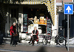 AMSTERDAM - NETHERLANDS - 19 OCTOBER 2004-- A woman enjoying the last rays of sunshine of the autumn, while having a cheese sandwich on the terrace of a cheese-shop cafe.-- PHOTO:  EUP-IMAGES / JUHA ROININEN