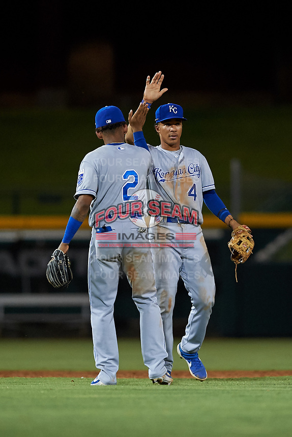 AZL Royals infielders Herard Gonzalez (2) and Enrique Valdez (4) celebrate a victory after an Arizona League game against the AZL Cubs 1 on June 30, 2019 at Sloan Park in Mesa, Arizona. AZL Royals defeated the AZL Cubs 1 9-5. (Zachary Lucy/Four Seam Images)