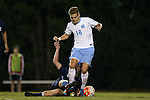 06 October 2015: North Carolina's Alan Winn (18) is fouled by UNCW's Kellen Foster (below). The University of North Carolina Tar Heels hosted the University of North Carolina Wilmington Seahawks at Fetzer Field in Chapel Hill, NC in a 2015 NCAA Division I Men's Soccer match. North Carolina won the game 3-0.