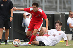 30 August 2015: Saint Mary's Austin Allison (5) avoids a tackle by Elon's Luis Argudo (11). The Elon University Phoenix played the Saint Mary's College Gaels at Koskinen Stadium in Durham, NC in a 2015 NCAA Division I Men's Soccer match. Elon won the game 1-0.