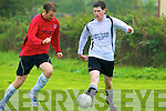 Castlegregory Celtic's Greg Dowling and Asdee Rovers Joseph O'Brien..