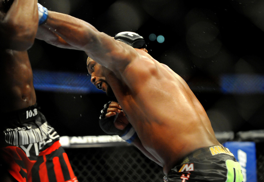 "24 SEPTEMBER 2011:  Quinton ""Rampage"" Jackson lands a punch during the bout against Jon ""Bones"" Jones   during UFC 135 at the Pepsi Center in Denver, Colorado. *****For Editorial Use Only*****"