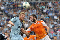 Oriol Rosell (20) midfield Sporting KC goes up for  a header with Adam Moffat (16) midfield Houston Dynamo ..Sporting Kansas City and Houston Dynamo played to a 1-1 tie at Sporting Park, Kansas City, Kansas.