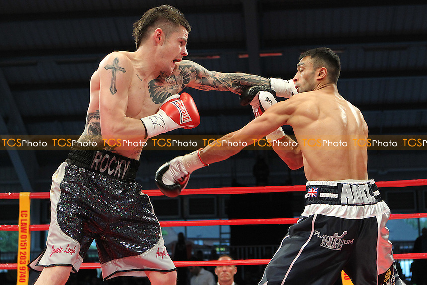 Adil Anwar vs Dave Ryan in a boxing contest at the Aintree Equestrian Centre, Liverpool, promoted by Frank Maloney - 19/05/12 - MANDATORY CREDIT: Chris Royle/TGSPHOTO - Self billing applies where appropriate - 0845 094 6026 - contact@tgsphoto.co.uk - NO UNPAID USE..