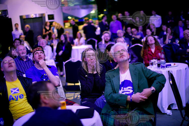 Supporters of the 'Yes' campaign for Scottish independence gathered in Edinburgh react to news reports of the result as they come in from across the country on the night of 18 September into morning of 19 September. The 'Yes' campaign lost the vote, keeping Scotland in the UK.