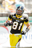 July 10, 2010; Hamilton, ON, CAN; Hamilton Tiger-Cats fullback Steve Schmidt (81). CFL football: Calgary Stampeders vs. Hamilton Tiger-Cats at Ivor Wynne Stadium. The Tiger-Cats lost against the Stampeders 23-22. Mandatory Credit: Ron Scheffler. Copyright (c) 2010 Ron Scheffler.