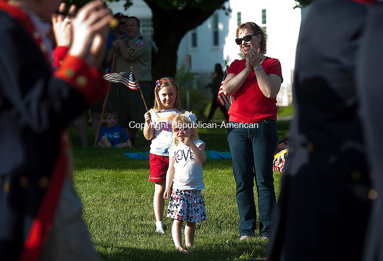 MIDDLEBURY, CT-052514JS07--Amanda Pistawka, 7, her sister Alyssa, 3 and mother Tanya, all of Middlebury, watch as the Mattatuck Fife and Drum march past during the annual Memorial Parade Sunday in Middlebury. <br /> Jim Shannon Republican-American
