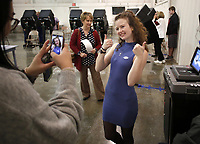 NWA Democrat-Gazette/DAVID GOTTSCHALK Martha Arambel, 18, poses for a photograph by Cindy Mao, a senior at Fayetteville High School, Tuesday, November 6, 2018, after casting her  ballot at the Ridgeview Baptist Church Voting Center in Fayetteville. Arambel celebrated turning 18 by voting for the first time on her birthday.