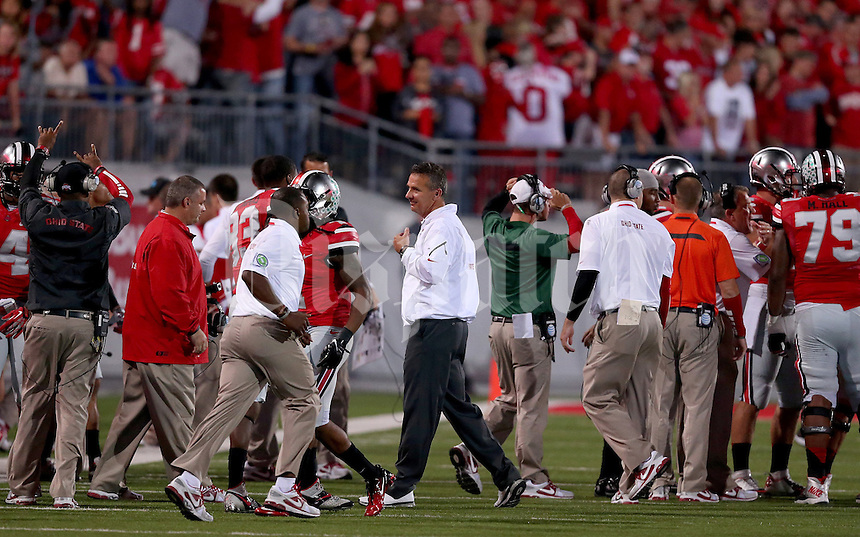Ohio State Buckeyes head coach Urban Meyer smiles after the game between Ohio State and Wisconsin at Ohio Stadium on Saturday, September 28, 2013. (Columbus Dispatch photo by Jonathan Quilter)
