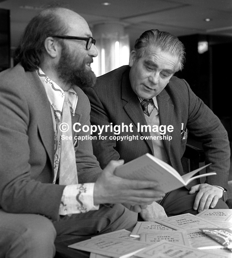 Sammy Smyth, founder member, early public face, UDA, Ulster Defence Association, right, receives a copy of a booklet containing Irish translations of common Ulster family names from Padraig O Snodaigh, president, Gaelic League. They met in the Europa Hotel, Belfast. 197504000384a<br />