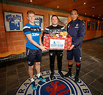 Ross McCrorie, Bruno Alves and Graeme Murty with boxes for the Rangers Charity food bank collection