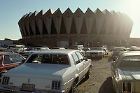 The sun is setting behind the Hampton Coliseum as seen in the parking lot. Scenes before the Second Warlocks Show. The Grateful Dead Live at The Hampton Coliseum 9 October 1989