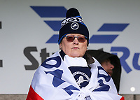 17th March 2019, The Den, London, England; The Emirates FA Cup, quarter final, Millwall versus Brighton and Hove Albion; Millwall fan with St.Georges flag wrapped around her looks on from the Cold Blow Lane stand