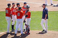 Virginia Cavaliers Head Coach Brian O'Connor on the mound to change a pitcher against the Florida Gators in Game 11 of the NCAA College World Series on June 19, 2015 at TD Ameritrade Park in Omaha, Nebraska. The Gators defeated Virginia 10-5. (Andrew Woolley/Four Seam Images)