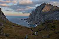 A small stream flows through Trolldalen valley above Bunes beach, Moskenesøy, Lofoten Islands, Norway