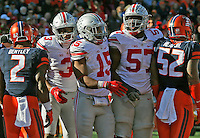 Ohio State Buckeyes running back Ezekiel Elliott (15) is congratulated by Ohio State Buckeyes offensive lineman Chase Farris (57) and Ohio State Buckeyes wide receiver Michael Thomas (3) after his one yard touchdown dive in the second half of their game at Memorial Stadium in Champaign, Ill on November 14, 2015. (Columbus Dispatch photo by Brooke LaValley)