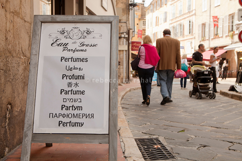 Perfume shop sign in La Place aux Aires, Grasse, France, 4 May 2013. There are many small perfume shops in the town, many targeting tourists who come from all over to visit the world's perfume capital.