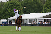 Fecund Pieres (King Power Foxes) has a shot at goal and scores during the Cartier Queens Cup Final match between King Power Foxes and Dubai Polo Team at the Guards Polo Club, Smith's Lawn, Windsor, England on 14 June 2015. Photo by Andy Rowland.