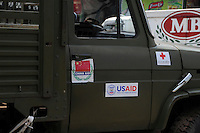 In the wake of Cyclone Nargis, an army truck sports various international donor logos including USAID and China Aid as it leaves the depot having collected donations from the airport. Cyclone Nargis hit Burma on 02/05/2008.