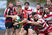 Dylan Walters is tackled by Salesitangi Savelio. Counties Manukau Premier Club Rugby game between Papakura and Karaka played at Massey Park Papakura on Saturday May 5th 2018. Papakuar won the game 28 - 25 after trailing 6 - 12 at halftime.<br /> Papakura - Faalae Peni, Darryl Hemopo, George Crichton, Federick Cain tries, Faalae Peni conversion; Faalae Peni 2 penalties, Karaka -Salesitangi Savelio, Cardiff Vaega, Walter Fifita tries, Juan Benadie 2 conversions, Juan Benadie 2 penalties.<br /> Photo by Richard Spranger.