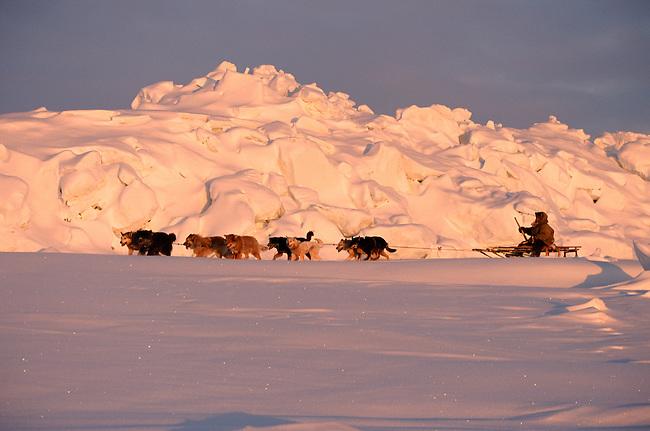 Geora Eymetitin, a Chukchi, drives his dog team by a pressure ridge near Cape Dezhnev.Chukotka, Siberia.
