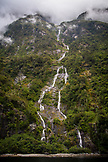 NEW ZEALAND, Fiordland National Park, Waterfalls in Milford Sound, Ben M Thomas