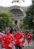 Fans stream into Ohio Stadium wearing scarlet ponchos prior to the NCAA football game against Florida A&M in Columbus on Sept. 21, 2013. (Adam Cairns / The Columbus Dispatch)