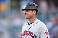 Indianapolis Indians manager Andy Barkett (19) coaches third base during the game against the Charlotte Knights at BB&T BallPark on June 16, 2017 in Charlotte, North Carolina.  The Knights defeated the Indians 12-4.  (Brian Westerholt/Four Seam Images)