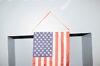 An American flag hangs from a wall after former Pennsylvania senator and Republican presidential candidate Rick Santorum spoke to an audience at the Concord office of New England College in Concord, New Hampshire.