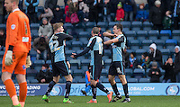Luke O'Nien of Wycombe Wanderers dances with Jason McCarthy of Wycombe Wanderers as they celebrate going 1 0 in front during the Sky Bet League 2 match between Wycombe Wanderers and Bristol Rovers at Adams Park, High Wycombe, England on 27 February 2016. Photo by Andrew Rowland.