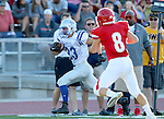 SIOUX FALLS, SD, AUGUST 27: Peyton Oxner #23 from Rapid City Stevens scampers down the sideline for a touchdown past  Stan Larson #8 from Sioux Falls Lincoln in the first half of their game Saturday night at Howard Wood Field. (Photo by Dave Eggen/Inertia)
