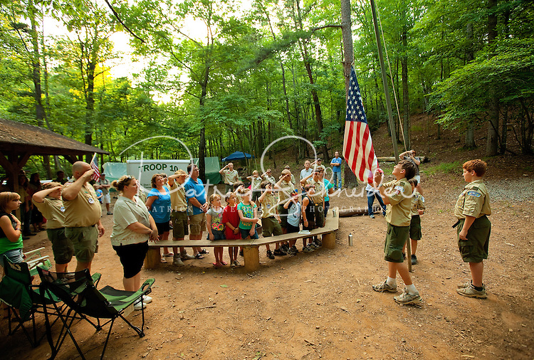 Boy Scouts attending Boy Scout resident camp at Camp Raven Knob in summer 2010 hold a flag raising ceremony during a visit from parents. Camp Raven Knob Scout Reservation, one of the largest Boy Scout camps in the United States, is located within Boy Scouts of America's Old Hickory Council in Mt. Airy, North Carolina. Troops from across the US attend the camp's one-week residential boys' summer programs, which offer instruction on more than 40 merit badges, adventure programs and new Scout orientation.