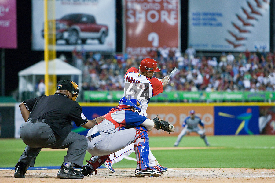 7 March 2009: #7 Ivan Rodriguez of Puerto Rico hits an homerun during the 2009 World Baseball Classic Pool D match at Hiram Bithorn Stadium in San Juan, Puerto Rico. Puerto Rico wins 7-0 over Panama.