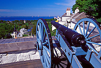 A CANON LOOKS OUT FROM ATOP FORT MACKINAC ON MACKINAC ISLAND, MICHIGAN
