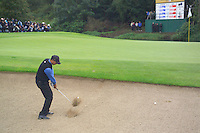 Ryder Cup 206 K Club, Straffin, Ireland...American Ryder Cup team player Tiger Woods chips out of the bunker on the 1st hole during  the  morning fourballs session of the second day of the 2006 Ryder Cup at the K Club in Straffan, Co Kildare, in the Republic of Ireland, 23 September 2006...Photo: Eoin Clarke/ Newsfile.