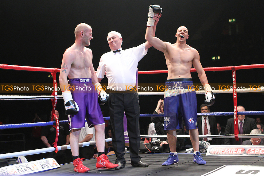 Andreas Evangelou (blue shorts) defeats Jody Meikle (purple shorts) at  Wembley Arena,  promoted by Hennessy Sports - 19/02/11 - MANDATORY CREDIT: Chris Royle/TGSPHOTO - Self billing applies where appropriate - 0845 094 6026 - contact@tgsphoto.co.uk - NO UNPAID USE..