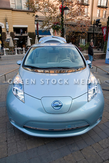 Front view of Nissan Leaf electric car. Nissan Leaf Zero Emission Tour promotional event for the Nissan Leaf electric car that is scheduled to be released in Fall 2010. Car specs from Nissan: 5 person capacity, 90 MPH top speed, lithium-ion battery, 100 mile average range per charge. Santana Row, San Jose, California, USA, 12/5/09
