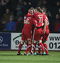 Sean Canham of Kidderminster (on loan from Hereford) (2nd left) is mobbed by team-mates after scoring the first goal during the Blue Square Bet Premier match between Cambridge United and Kidderminster Harriers at the Abbey Stadium, Cambridge on 18th February, 2011 .© Kevin Coleman 2011.