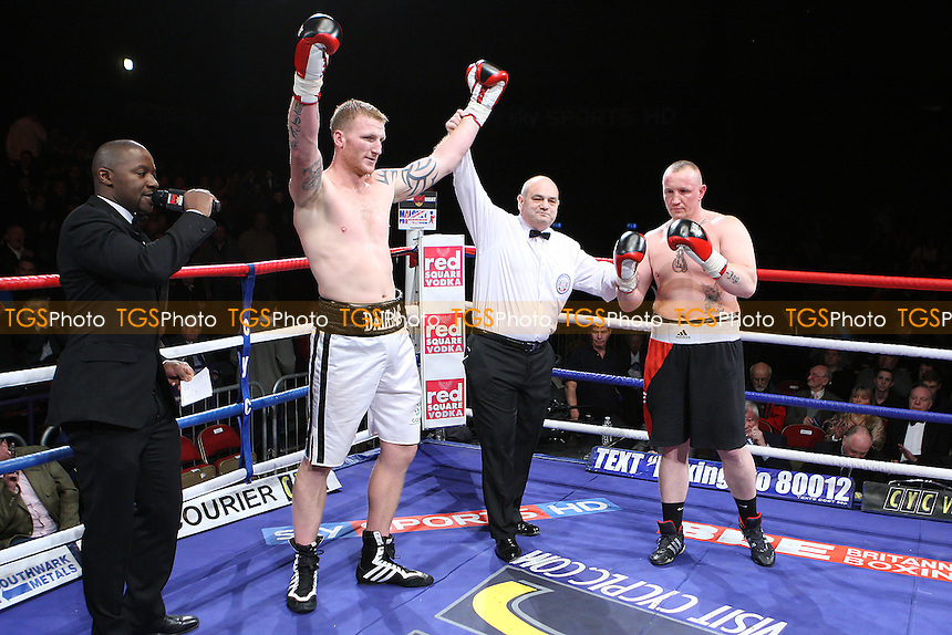 Tom Dallas (white shorts) defeats Werner Kreiskott in a Heavyweight boxing contest at the Brentwood Centre, promoted by Frank Maloney - 05/02/11 - MANDATORY CREDIT: Gavin Ellis/TGSPHOTO - Self billing applies where appropriate - Tel: 0845 094 6026