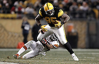 PITTSBURGH, PA - DECEMBER 08: David Johnson #85 of the Pittsburgh Steelers attempts to break a tackle after catching a pass against the Cleveland Browns during the game on December 8, 2011 at Heinz Field in Pittsburgh, Pennsylvania.  (Photo by Jared Wickerham/Getty Images)